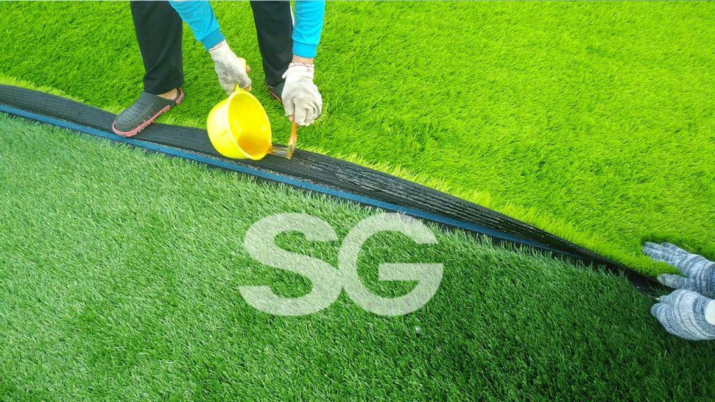 Dán cỏ nhân tạo sân bóng